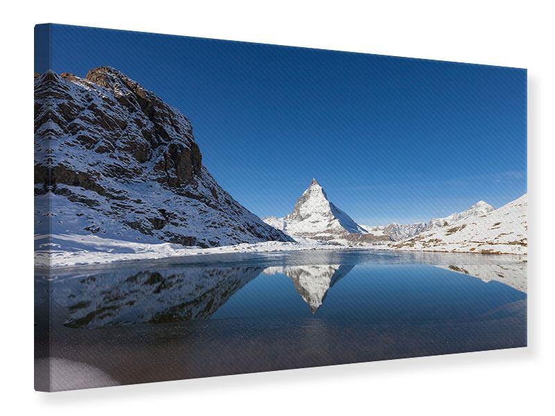 Leinwandbild Blau-Der-Riffelsee-am-Matterhorn Querformat